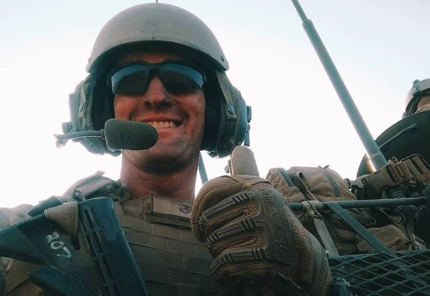 Marine 1st Lt. H. Conor McDowell as troop commander of a Light Armored Vehicle (LAV).