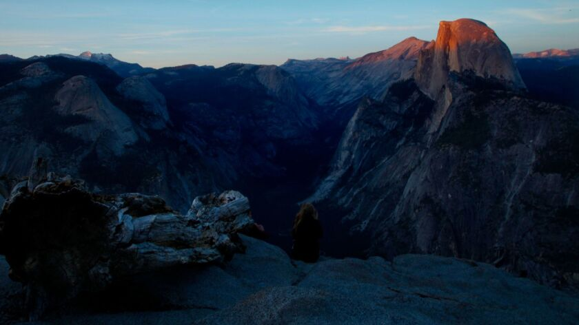 YOSEMITE, CA., MAY 20, 2013: The last rays of sunshine dance across the top of Half Dome in this vie