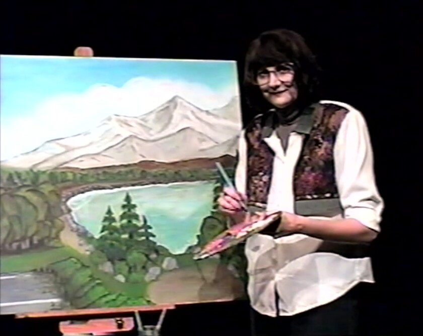 "Kerri Kenney as Joan, the host of the parody TV show ""Painting With Joan"" in ""VHYes."""