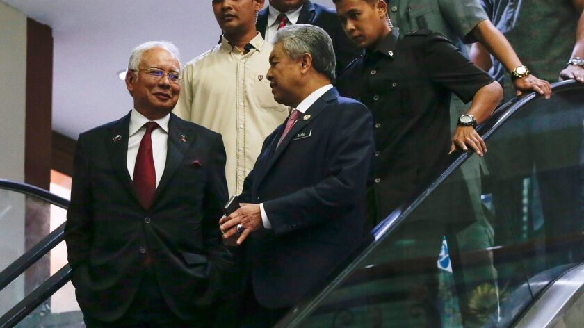 Malaysian Prime Minister Najib Razak, left, and Deputy Prime Minister Ahmad Zahid Hamidi leave the Royal Malaysia Air Force base after a National Security Council emergency meeting in Subang on March 7, 2017.