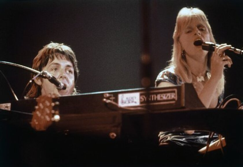 Linda McCartney is shown above in concert in 1976 with Paul McCartney, her husband and musical partner. An acclaimed photographer, Linda died in 1998, after being diagnosed with breast cancer. She was 56.