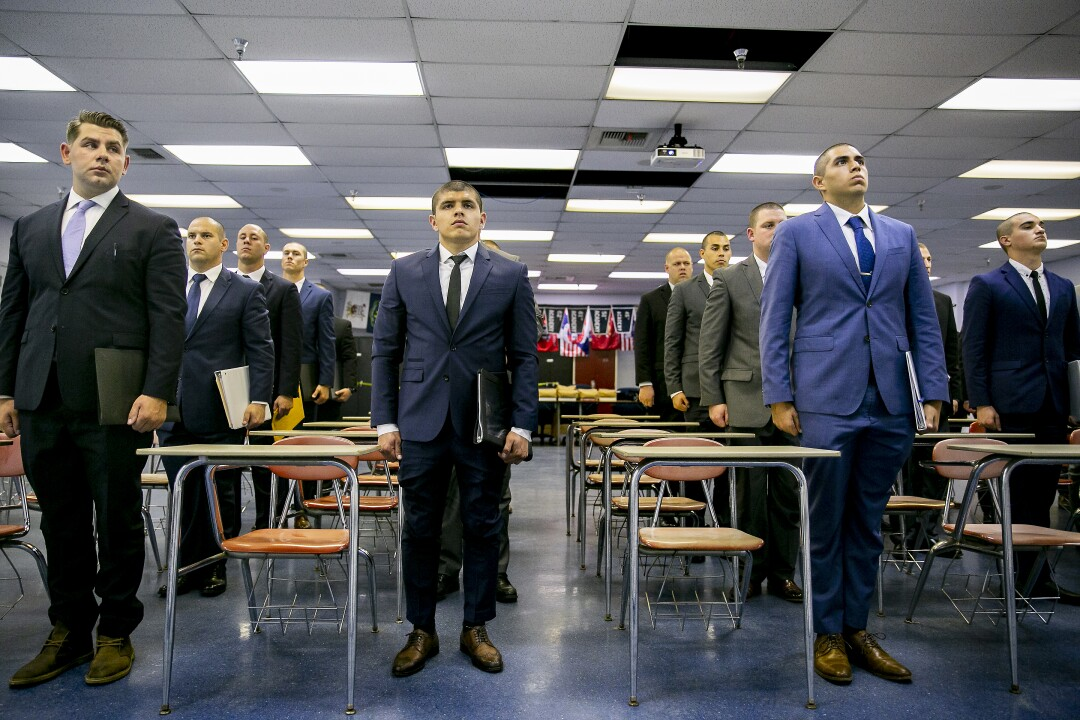 Costa Elizarraraz, center, stands at attention in the classroom alongside fellow recruits on orientation day for the 87th Academy.