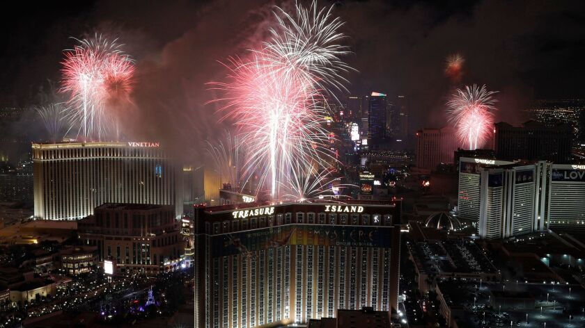 Fireworks explode over the Las Vegas Strip during the New Year's Eve celebration.
