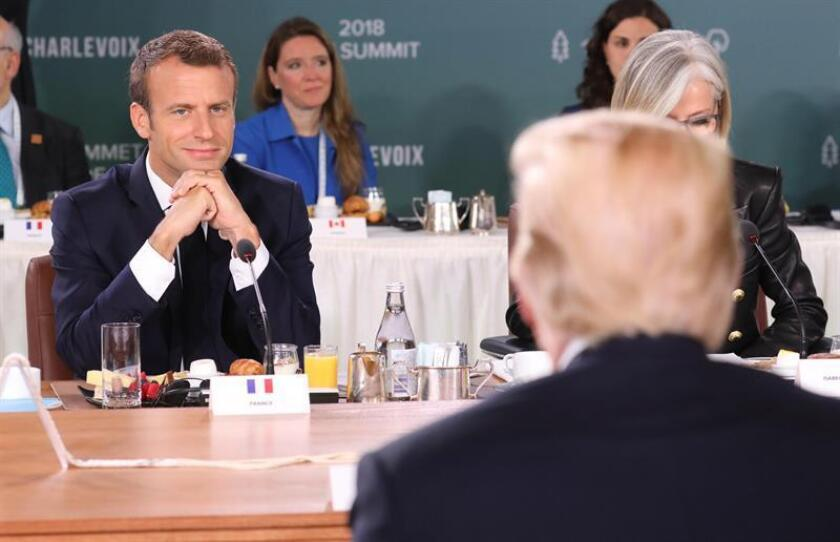 French President Emmanuel Macron (L) looks at US President Donald J. Trump (R) as they attend the G7 and Gender Equality Advisory Council Breakfast at the G7 summit in Charlevoix in Canada 09 June 2018. EFE/EPA
