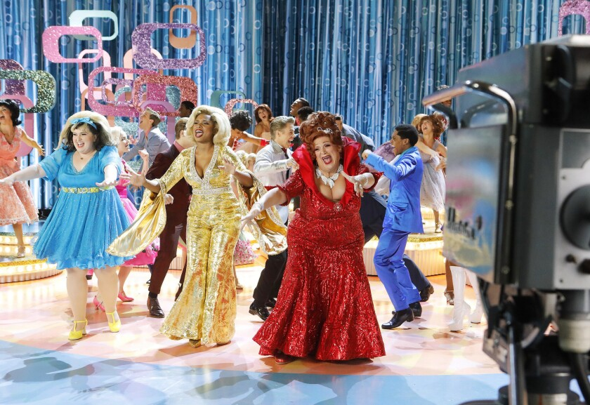 """Maddie Baillio, left, as Tracy Turnblad, Jennifer Hudson as Motormouth Maybelle, Harvey Fierstein as Edna Turnblad during a rehearsal for """"Hairspray Live!,"""" airing Wednesday."""