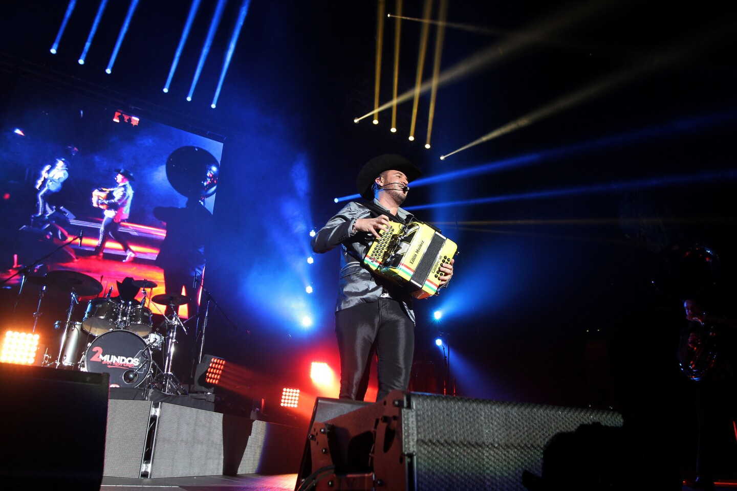 Gerardo Ortiz and Calibre 50 performs at The Forum on February 13, 2016 in Inglewood, California. (Photo by: DDPixels.com)