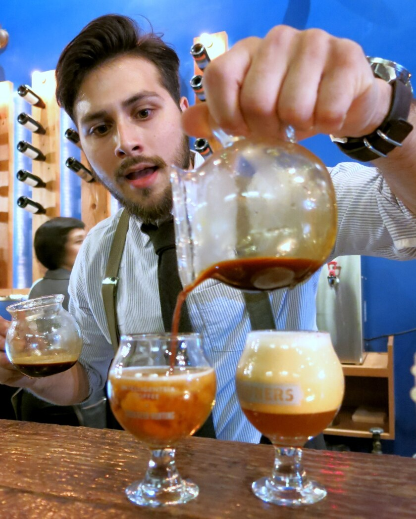 Brandon Mannino pours a coffee-beer cocktail at Uppers and Downers.