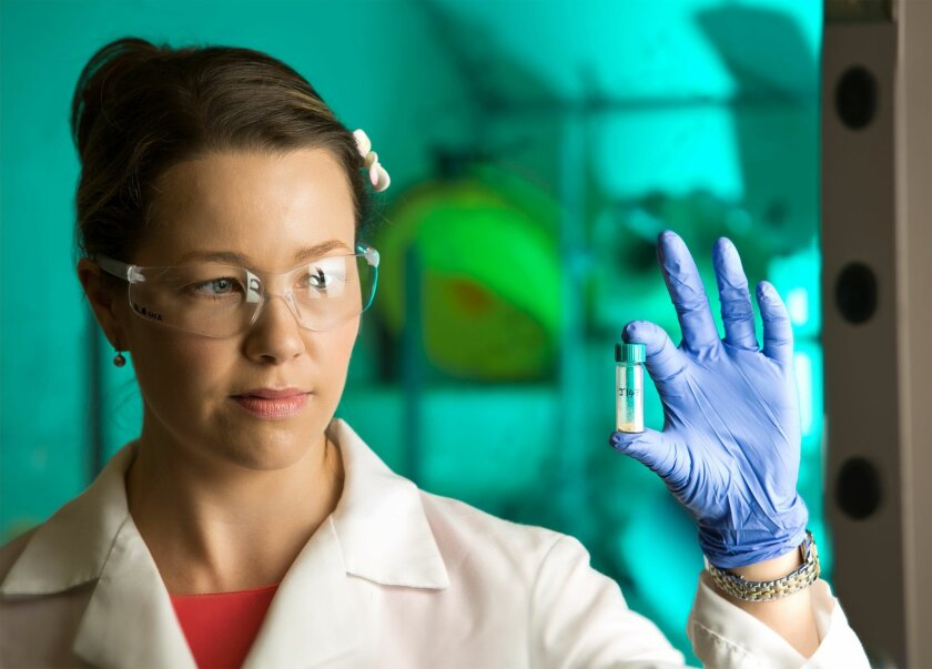 Salk Institute researcher Marguerite Prior holds a vial of J147, a potential Alzheimer's drug that has reversed symptoms of the disease in mouse studies.