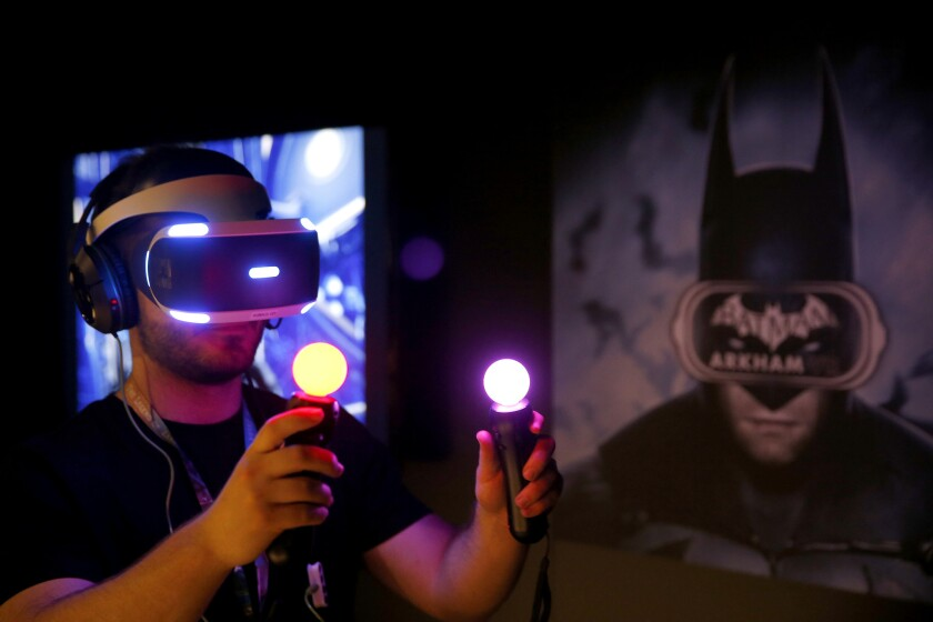 "Jordan Maron plays Warner Bros. Interactive and DC Entertainment's ""Batman: Arkham VR"" during the Electronic Entertainment Expo."