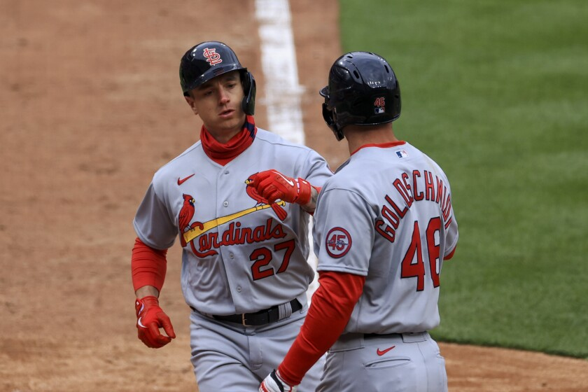 St. Louis Cardinals' Tyler O'Neill, left, celebrates hitting a two-run home run with teammate Paul Goldschmidt during the fourth inning of the baseball game against the Cincinnati Reds in Cincinnati, Thursday, April 1, 2021. (AP Photo/Aaron Doster)