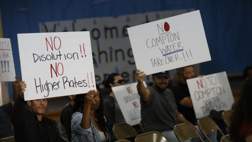 COMPTON, CA - JUNE 18, 2018 - Attendees show their support of the water district during a Water Qual