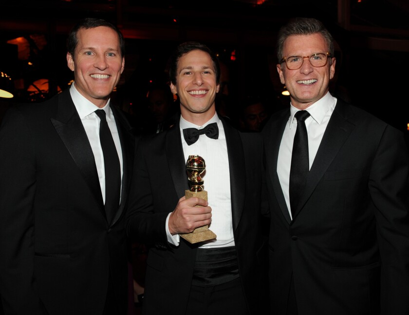 Fox Broadcasting announced a new executive structure that streamlines the executive ranks and entrusts more power to network Chief Operating Officer Joe Earley, left. Earley is shown with actor Andy Samberg, center, and Fox Entertainment Chairman Kevin Reilly at the Fox Golden Globe Awards party.