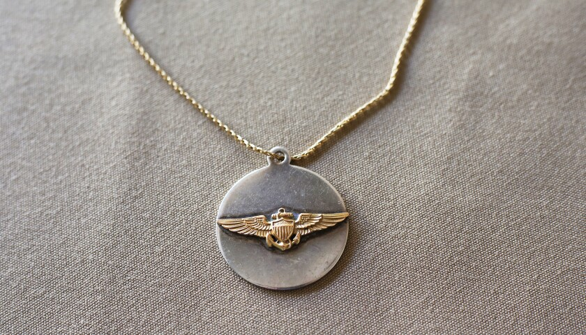 Mary Crosby, widow of downed Vietnam War Navy pilot Lt. Cmdr. Frederick Crosby, wore this pendant ma