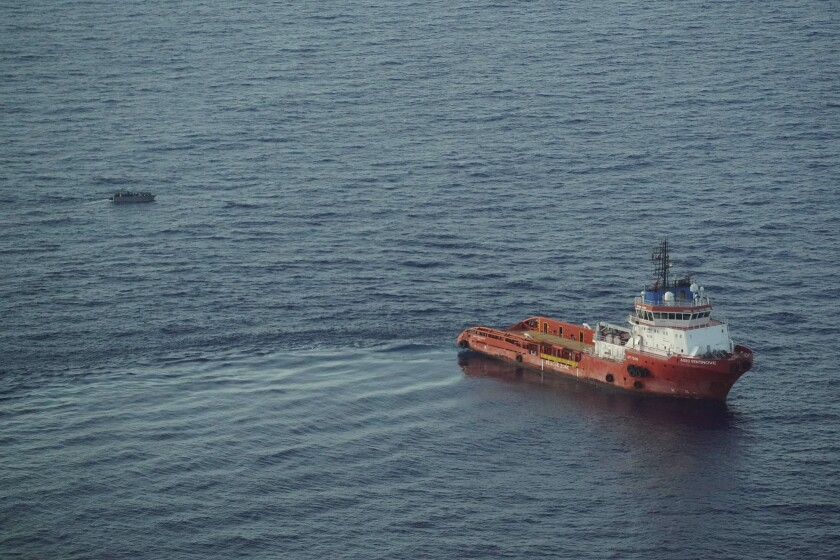 The Italian supply vessel, Asso Ventinove is seen from aboard the Seabird, an NGO aircraft, as it prepares to rescue persons from aboard a migrant boat drifting in the central Mediterranean Sea near the Bouri oilfields north of Libya, Saturday, Oct. 2, 2021. The offshore supply vessel on Saturday rescued dozens of migrants, including women and children, fleeing Libya to Europe on a crowded, wooden boat. (AP Photo/Renata Brito)