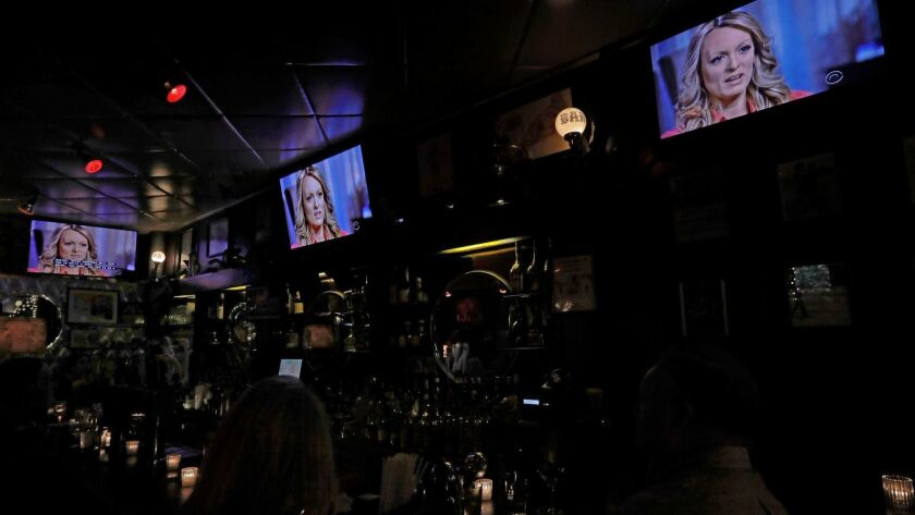 """Anderson Cooper's interview with Stormy Daniels on """"60 Minutes"""" on Sunday became a major television event. It was shown on all TV screens at New York's Hi Life Bar & Grill."""