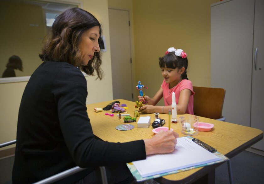 Dr. Cindy Carter Barnes, a psychologist with UC San Diego, conducted a diagnostic assessment for autism spectrum disorder on 9-year-old Aiko Voit on Thursday. / photo by Howard Lipin * U-T