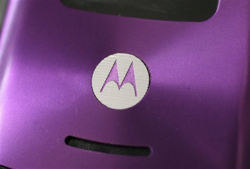 In this March 26, 2008 file photo, the Motorola logo on a cell phone is seen in a store in New York. Mobile handset maker Motorola Inc. on Wednesday, Jan. 14, 2009 said it will cut 4,000 more jobs in 2009, in addition to 3,000 it announced last year. (AP Photo/Mark Lennihan, file)