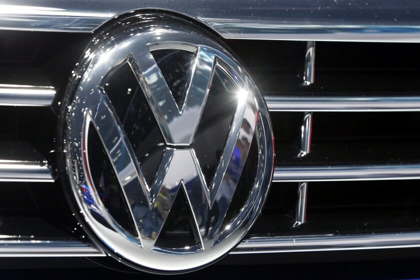 FILE - In this Sept. 22, 2015, file photo, the logo of Volkswagen is displayed on a car during the Car Show in Frankfurt, Germany. German prosecutors say they have widened their investigation of Volkswagen to include suspicion of tax evasion after revelations that some of its cars were emitting more carbon dioxide than officially reported. Braunschweig prosecutor Birgit Seel told The Associated Press on Tuesday Nov. 24, 2015 that the investigation was focused on five Volkswagen employees but would not release their names. (AP Photo/Michael Probst, File)