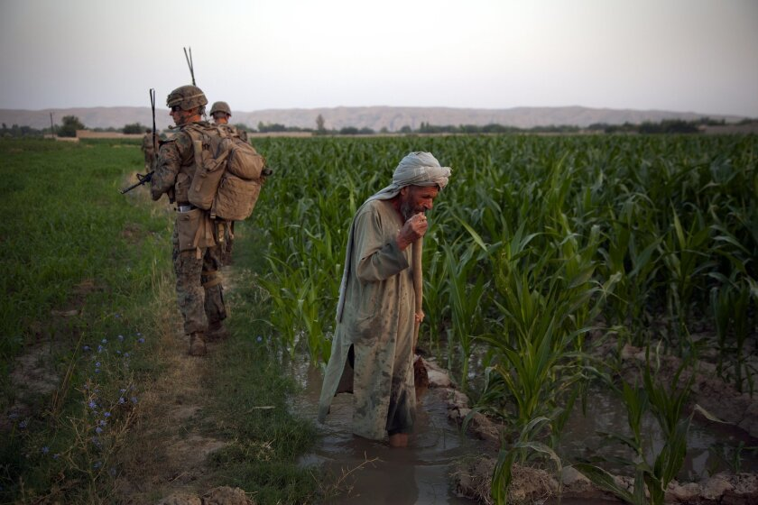 Staff Sgt. Trent Templet, of 1st Battalion, 7th Marine Regiment, leads his platoon and Afghan troops on a 14-hour patrol in Sangin this summer.