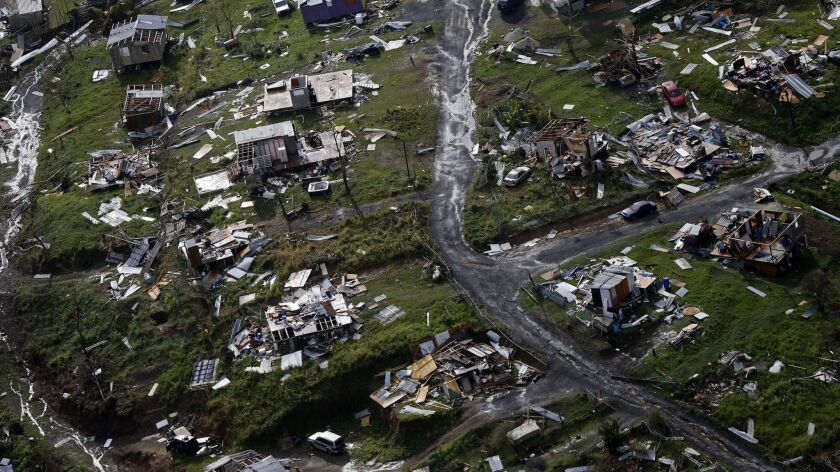 The rubble of homes in the aftermath of Hurricane Maria in Toa Alta, Puerto Rico on Sept. 28, 2017.