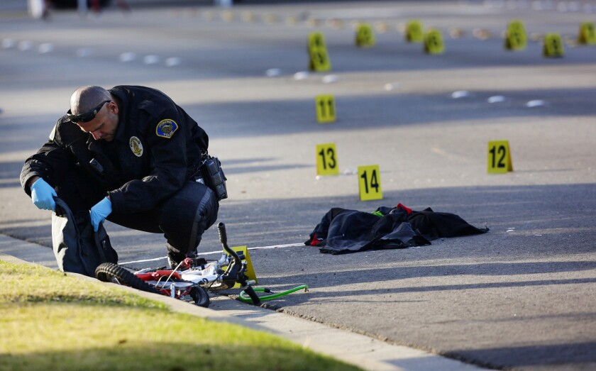 Authorities on Thursday investigate the site of where a Foothill Transit bus struck and killed a bicyclist on White Avenue, between Orange Grove and Holt avenues.