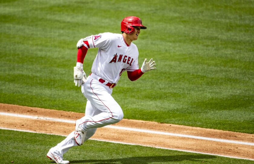 Angels designated hitter Shohei Ohtani runs the bases after hitting a solo homer.