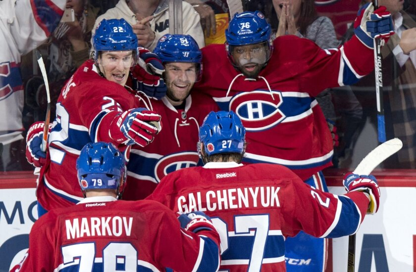Montreal Canadiens' David Desharnais (51) celebrates his goal against the Boston Bruins with teammates, from left to right, Andrei Markov, Dale Weise, Alex Galchenyuk and P.K. Subban during third period NHL hockey action, in Montreal, on Saturday, Nov. 7, 2015. The Canadiens beat the Bruins 4-2. (P