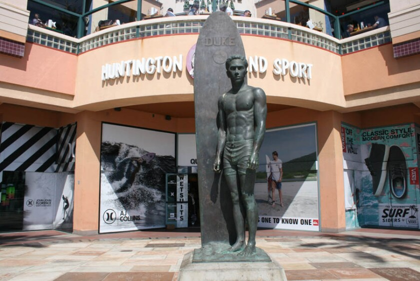A bronze sculpture of Duke Kahanamoku, known as the father of modern surfing, is at Pacific Coast Highway and Main Street in Huntington Beach. City officials are seeking public input to help develop a public art master plan.