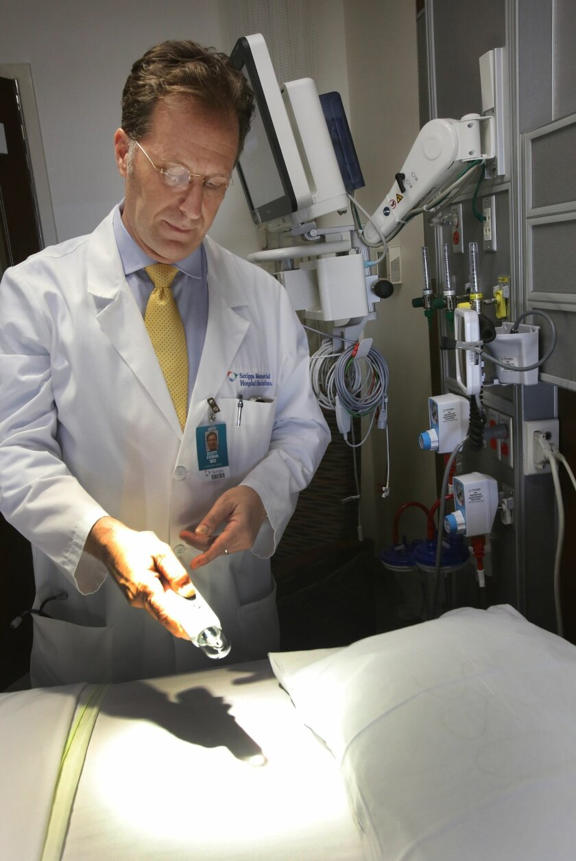 Dr. Scott Eisman demonstrates a lighting remote-control system in a patient room at the new critical care building at Scripps Memorial Hospital in Encinitas. / photo by Bill Wechter * U-T San Diego