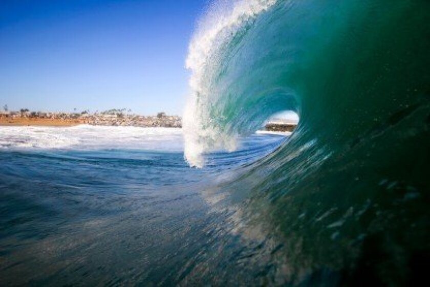 As one of the many massive waves from to the effects of Hurricane Marie roars onto the shores of Newport Beach, local photographer Austin Schmid was chronicling the intensity. Photo by Austin Schmid