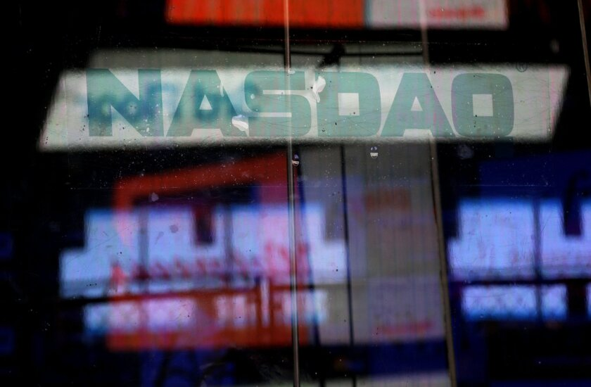 FILE - In this Thursday, Aug. 22, 2013, file photo, electronic billboards are reflected in the windows of Nasdaq in New York. The Nasdaq composite rose for an eighth straight day Friday, Feb. 20, 2015, pushing the index closer to its all-time closing high. (AP Photo/Seth Wenig, File)