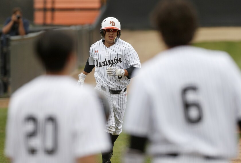 Huntington Beach High's Cole Minato (2) runs to home plate after he hit a two-run homer during the f