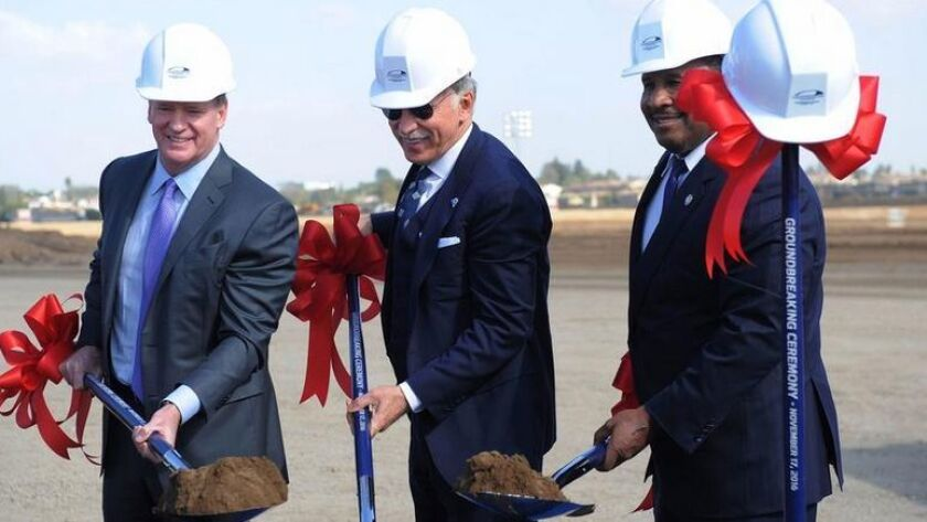 NFL commissioner Roger Goodell, Los Angeles Rams owner Stan Kroenke and Inglewood mayor James T. Butts pose for photos at the groundbreaking ceremony of L.A. Stadium and Entertainment District at Hollywood Park on Thursday.