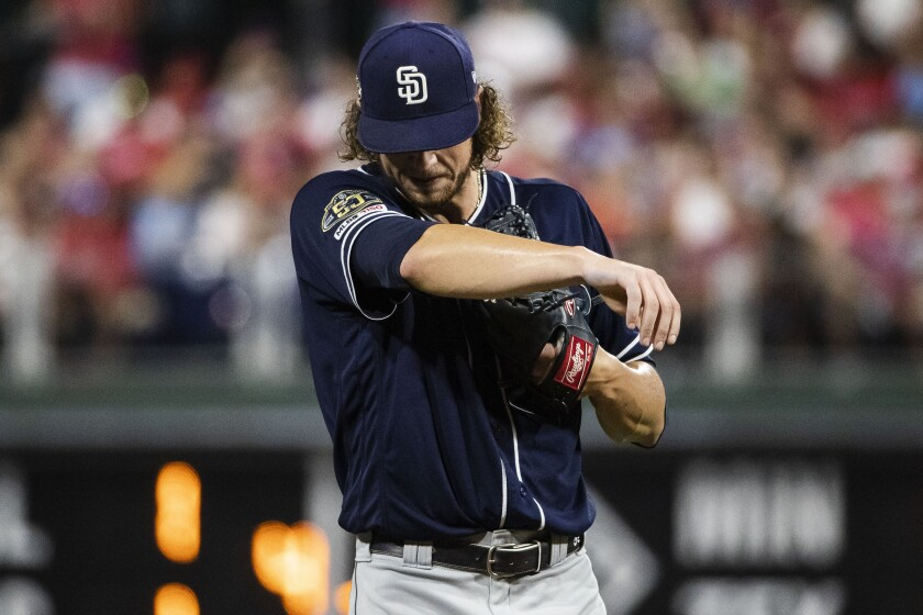 Padres starter Chris Paddack wipes his brow during the during the third inning of Friday night's game against the Phillies.
