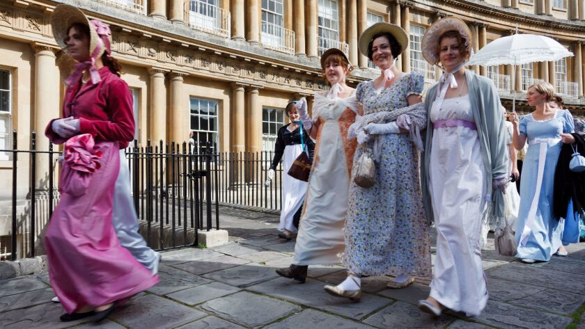 People dressed in period costume for the Jane Austen Festival in Bath, England.