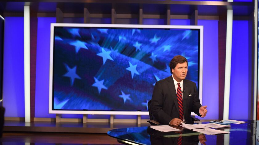 "Tucker Carlson on the New York set of his Fox News show, ""Tucker Carlson Tonight,"" in October."