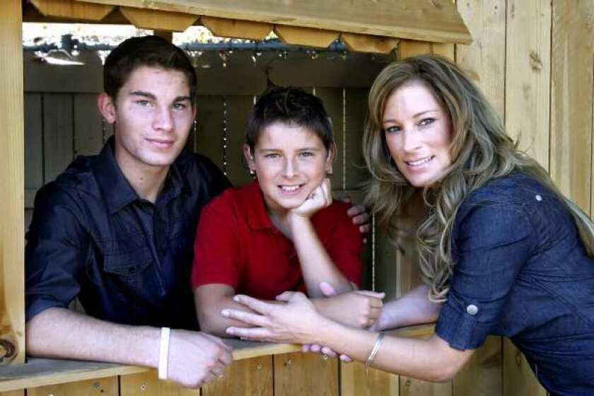 Josh, 17, Jacob, 11, and Sonia Desormeaux at their home in La Canada Flintridge.