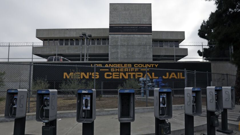 "Phone booths line the street near Men's Central Jail in downtown Los Angeles. The L.A. County Board of Supervisors voted Tuesday to approve $2.2 billion to replace the jail with a ""correctional treatment facility"" aimed at serving mentally and medically ill inmates."