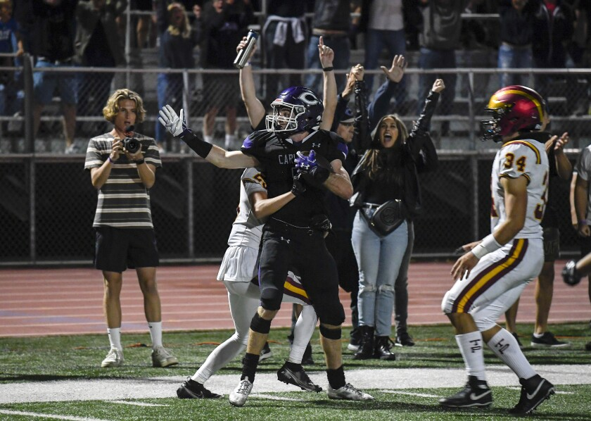 Carlsbad's Josh Davis celebrates after catching the winning touchdown pass on the game's final play against Torrey Pines.