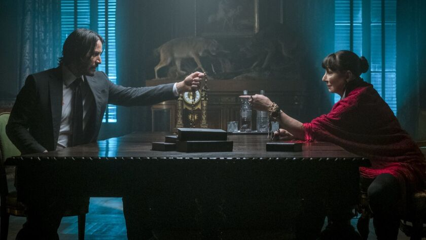 (L-R)- John Wick (Keanu Reeves) and Director (Anjelica Huston) in JOHN WICK: CHAPTER 3 - PARABELLUM.