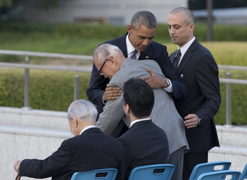 U.S. President Barack Obama hugs Shigeaki Mori, an atomic bomb survivor; creator of the memorial for American WWII POWs killed at Hiroshima, during a ceremony at Hiroshima Peace Memorial Park in Hiroshima, western Japan, Friday, May 27, 2016. Obama on Friday became the first sitting U.S. president