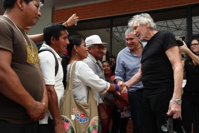 British musician Roger Waters (R) visits Lago Agrio, Ecuador, on Nov. 19, 2018, to learn about oil pollution in that region. EPA-EFE/Jose Jacome