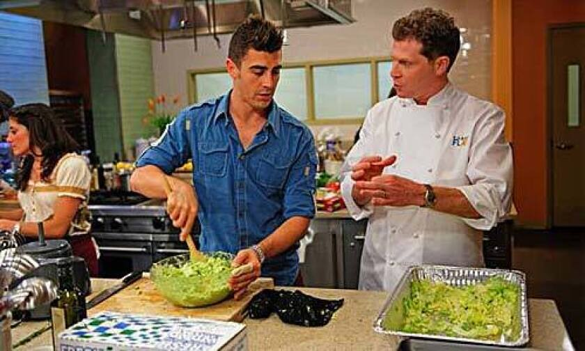 Competitor Eddie Gilbert on set with chef Bobby Flay.