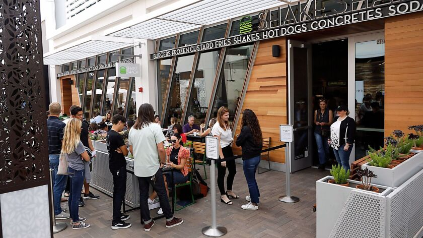 People line up for the VIP soft opening of Shake Shack at UTC Westfield.