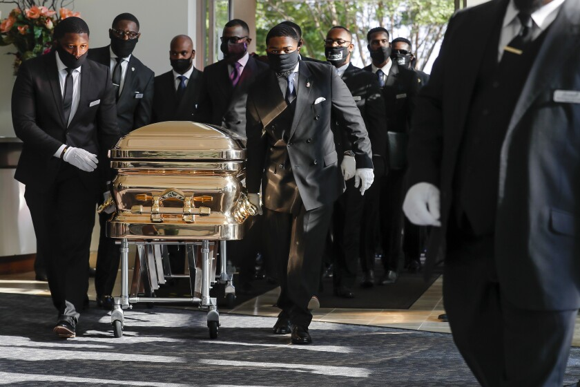 Pallbearers bring the coffin into The Fountain of Praise church in Houston for the funeral for George Floyd.