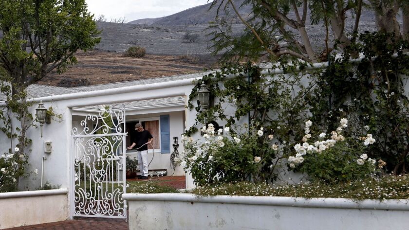 Don Fauntleroy's neighborhood in the Trancas Canyon area of Malibu is at risk for mudslides during winter rains. The surrounding hillsides were burned by the Woolsey fire.