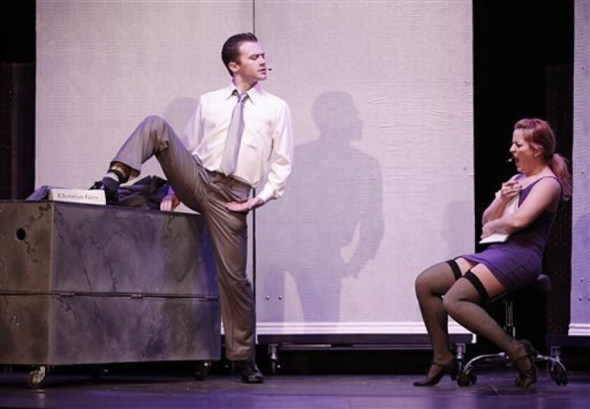 "This theater publicity image released by David Gersten & Associates shows Matthew Brian Bagley, left, and Laurie Elizabeth Gardner during a performance of ""Cuff Me: The Fifty Shades of Grey (Unauthorized) Musical Parody,"" in New York. (AP Photo/David Gersten & Associates, Carol Rosegg)"