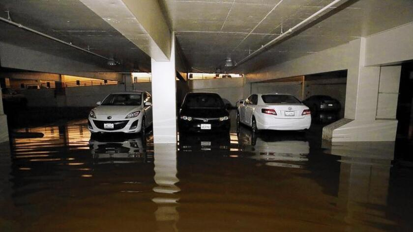 An estimated 900 vehicles are marooned in two parking garages at UCLA. Some were removed Thursday night.