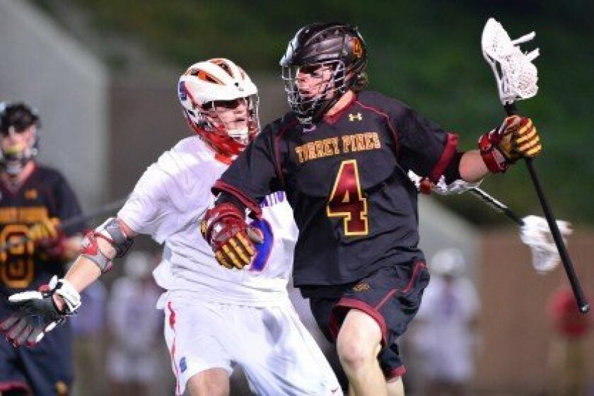 The Torrey Pines varsity lacrosse team took down St. Ignatius, one of the top lacrosse teams in the state, in a 7-6 win in Pasadena on March 14. Photo/Anna Scipione