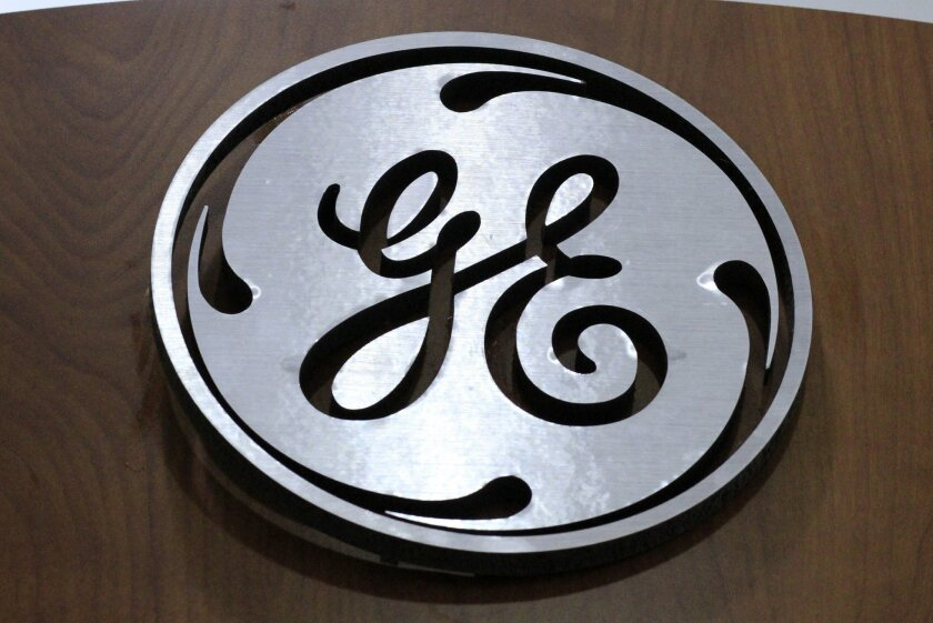 FILE - In this Thursday, Jan. 16, 2014, file photo, a General Electric logo is displayed at a store in Cranberry Township, Pa. General Electric announced Tuesday, Sept. 6, 2016, that it is continuing its push into the digital realm, spending $1.4 billion to acquire two European 3-D printing compani